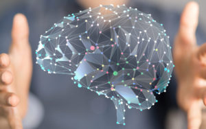 Hands surround a hologram of a brain dotted with multicolored points. This could represent brainspotting therapy in North Carolina. Contact a brainspotting therapist to learn about brainspotting for trauma, brainspotting risks, and other services.